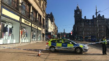Princes Street cordoned off February 21 2018 loose roofing concerns.