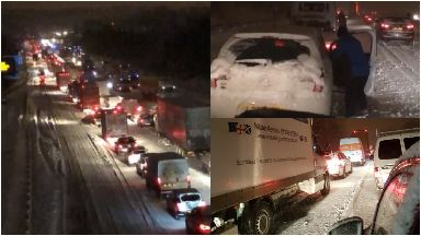 M80: Tailbacks for miles on motorway. Snow