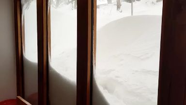 Rescued: House was cut off by snowdrifts.