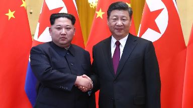 Mr Xi held talks with Mr Kim at the Great Hall of the People in Beijing.