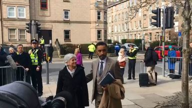 Clara Ponsati with Aamer Anwar outside St Leonards Police Station.