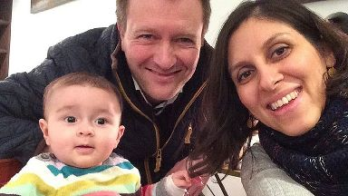 Nazanin Zaghari-Ratcliffe with her husband and child