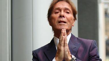 Sir Cliff Richard arrives at the Rolls Building in London, as a High Court judge is preparing to analyse evidence.