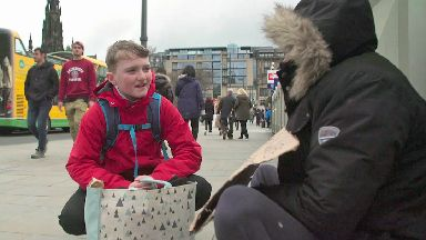 Joseph Cox handing out clean socks in Edinburgh as part of Socks for the Street