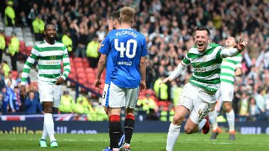 Callum McGregor celebrates scoring Celtic's second goal against Rangers.