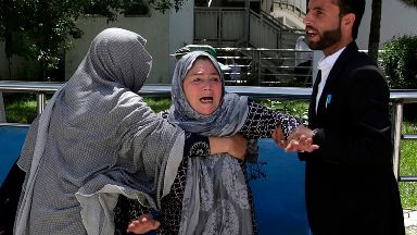 A woman outside a hospital after she lost her son in a suicide attack on a voter registration centre in Kabul,