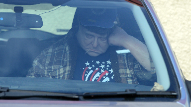 Police were called to a lifelike dummy of actor John Goodman sitting in a car after it was mistaken for a dead body outside Bill's Tools, Glasgow.