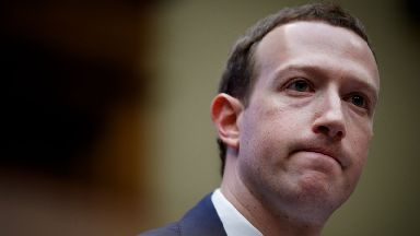 The Facebook founder could face a summons next time he's on British soil.