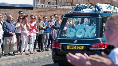 The funeral cortege of Alfie Evans goes past Everton's Goodison Park ground in Liverpool.