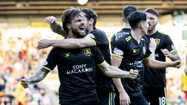 Keaghan Jacobs celebrates scoring the equaliser for Livingston against Partick Thistle.