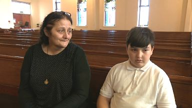 Giorgi Kakava, 10yo asylum seeker, with grandmother Ketino Baikhadze.