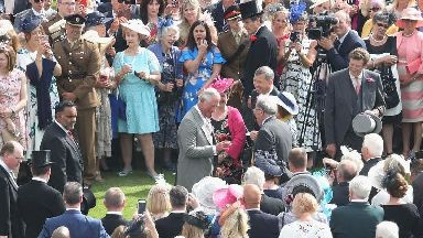 Charles meets longest-lasting milkman in the west at Palace garden party