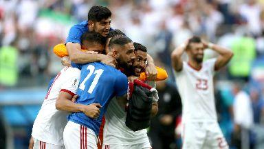 Iran players celebrate their dramatic late win.