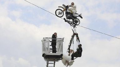 Love is in the air as German couple wed in swing dangling 46ft off the ground