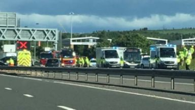 M90: Road at Halbeath closed by police. Fife