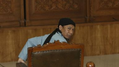 Radical Islamic cleric Aman Abdurrahman sits at the court room for his sentencing hearing