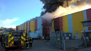 Fire rips through warehouse in east London