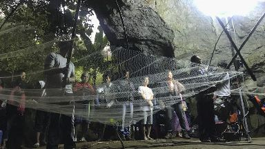 Divers re-enter cave in Thailand to search for 13 cut off by floods