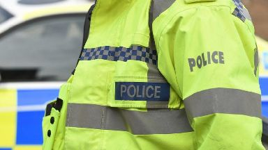 Man held on suspicion of attempted murder of police officer in axe incident