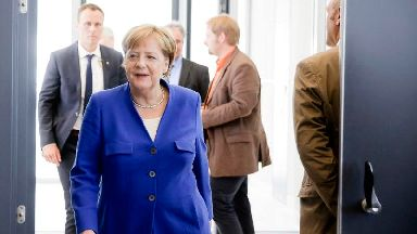 Merkel reaches compromise to end immigration row threatening government