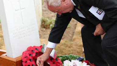 Nephew Frank Treasurer leaves a poppy at the grave of able seaman James Robertson