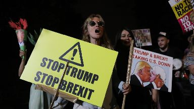 Anti-Trump: Demonstrators stand outside the US ambassador residence in Regent's Park, London.