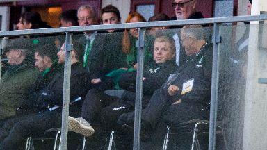 Neil Lennon watched Hibs' win from the stand.
