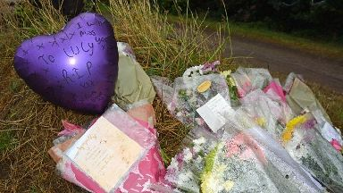 Suspect 'burned clothes in back garden' on day Lucy's body was found