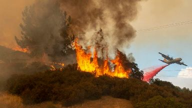 Wildfires barrel toward Northern California lake towns