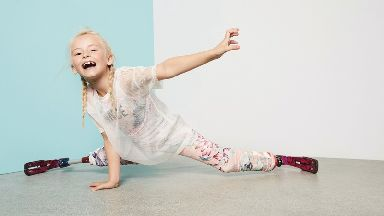 Eight-year old Daisy-May Demetre modelling for the River Island summer clothes range.