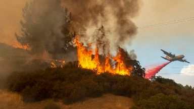 Crews report progress in fight against twin California fires