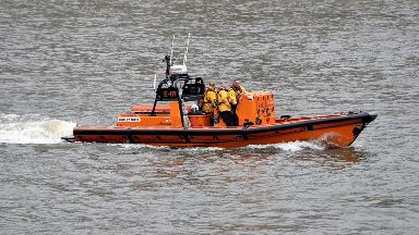 Police appeal to identify mystery man with dragon-like tattoo in Thames rescue
