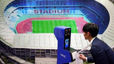 A staff member demonstrates a new face recognition system used for the Tokyo 2020 Olympic and Paralympic Games.