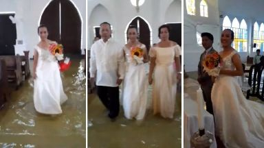Here comes the tide! But this smiling bride refused to be put off as she waded her way down the aisle