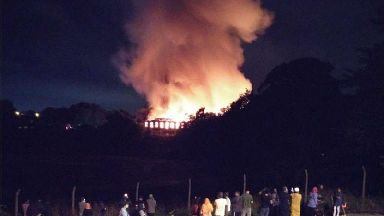 Homes evacuated as dozens of firefighters tackle huge mill blaze