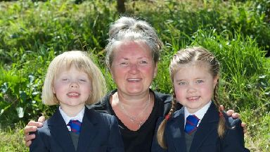 Twins Rowan and Isla Rodgerand theur mother Karen.