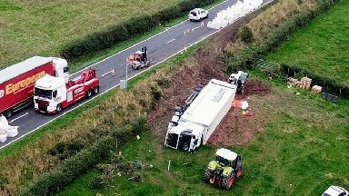 Lorry carrying carrots veers off road and overturns near Dumfries