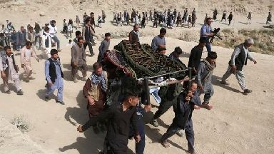 A funeral is held for one of the victims.