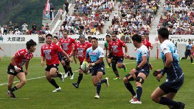 Yamaha Jubilo's Kira Tomokazu carry the ball during a memorial rugby match against Kamaishi Seawaves.