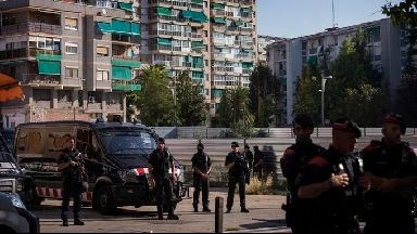 Catalan police officers cordon off the area following a knife attack at a police station.