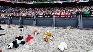 Soft toys surround the pitch.