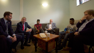 Labour leader Jeremy Corbyn (third right) and his Scottish counterpart Richard Leonard (second left) at Possilpark parish church in Glasgow to meet with asylum seekers who are being threatened with eviction by Serco.