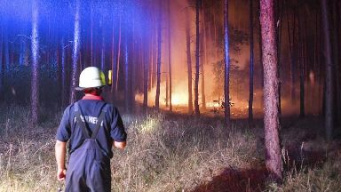 German villages evacuated as forest wildfire spreads