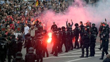 German police keep rival protests apart after man is killed