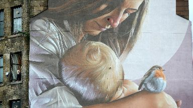 Mural depicting  St Enoch and her son St Mungo as a child in Glasgow.