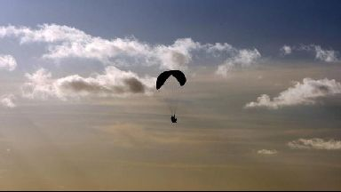 Paraglider allegedly intimidating people by being abusive.