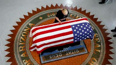 Family members lead mourners at memorial event for John McCain