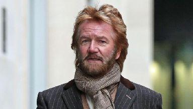 Noel Edmonds is seeking damages from Lloyds.