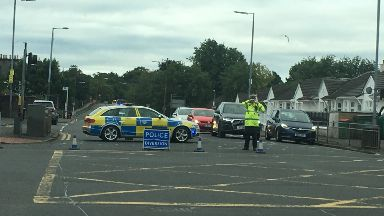 Crookston Road: Closed by police.
