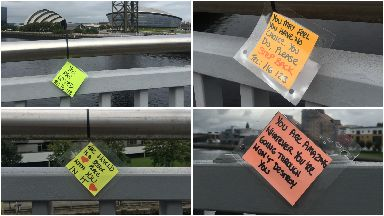 Notes on Squinty Bridge in Glasgow urging people not to commit suicide